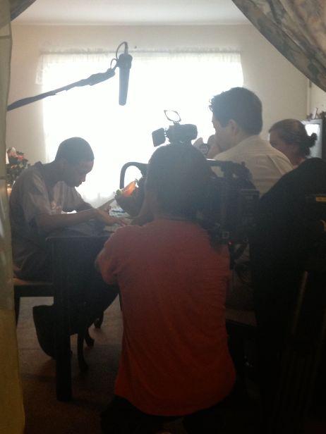 The NHK crew interview Quddus.