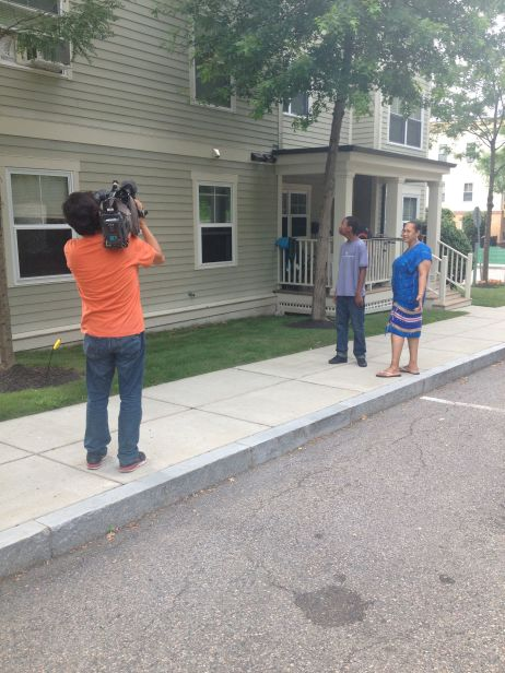 The NHK film crew captures Quddus and his mother strolling through their Dorchester Center neighborhood.