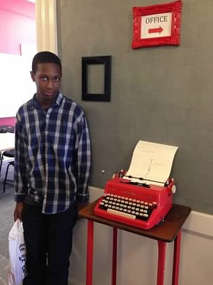 Quddus poses with the famous Grub Street red typewriter.