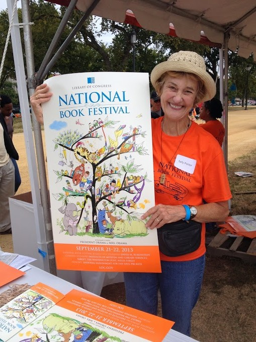 Upon arrival, this wonderful volunteer presented us with our orange bags and the beautiful book festival poster.