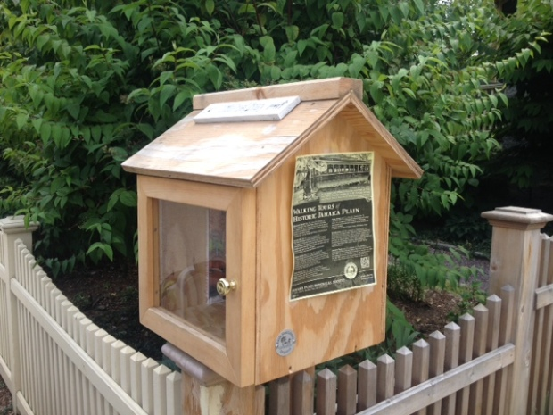 The Little Free Library serves as a community bulletin board space.